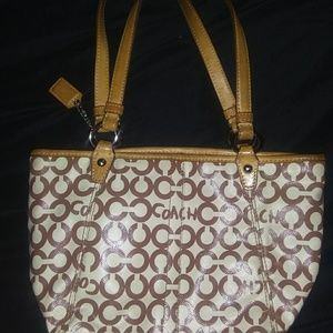 Brown and tan coach purse